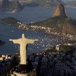 FILE - In this May 30, 2011 file photo, the statue of Christ the Redeemer and Sugarloaf Mountain make up part of the iconic landscape in Rio de Janeiro, Brazil. Officials say people returning from a visit to the statue on top of Rio de Janeiro's Corcovado mountain were stranded for close to two hours when the train they were riding broke down late Friday, Jan. 3, 2014. (AP Photo/Felipe Dana, File)